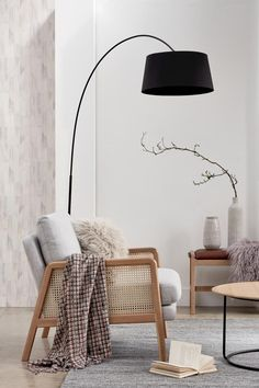 A floor lamp with a black shade adds definition in this vignette with a cane armchair and decorated side bench. Image by John Lewis. Interior Pastel, Estilo Interior, White Interior Design, Interior Decorating, Interior Lighting Design, Interior Logo, Simple Interior, Studio Interior, Decoration Inspiration