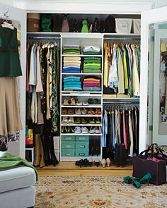 soooo organized!!    Think High, Low, and In Between  Floor-level space and top shelves can hold canvas boxes and bins for out-of-season clothing and shoes. Keep totes and handbags in sight but out of the way on the high shelf. To ensure that no space is wasted, you can even install a shelf above lower hanging rods to hold trays for scarves and gloves.