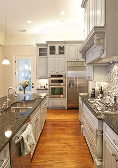 love the white cabinets w/ stainless appliances
