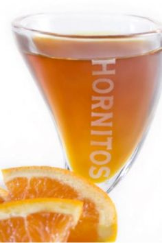 "Hornitos""Papasito"" :  Ingredients:    1 part Hornitos® Añejo Tequila    ½ part Tawny Port    ¼ part orange liqueur (DeKuyper® Premium Orange Liqueur is recommended)    Dash orange bitters      Directions:    Stir ingredients briskly and strain into a shot glass. Bite into an orange wedge and imbibe."