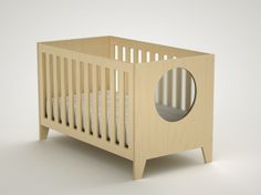 This is a very simple, sturdy and compact crib that introduces a distinct element: the round, acrylic window. The circular cut-out allows the baby to observe the outside world framed in a soft and round perspective. The crib mattress support has two positions: a high one for the first few months and a lower one. The crib also converts into a toddler. Because why buy a new bed when you JUST bought a crib?