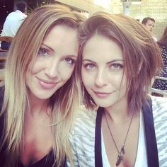 Katie Cassidy (Laurel Lance) and Willa Holland (Thea Queen) behind the scenes of Arrow.