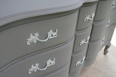 Paint an old wood dresser in gray and brass pulls in dove, now it looks French.
