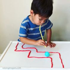 This playdough maze is a perfect STEAM activity and great for kids of all ages! Great for developing oral motor skills, creativity and teamwork! For Kids Ping Pong Playdough Straw Maze * ages ⋆ Raising Dragons Indoor Activities For Kids, Infant Activities, Home Games For Kids, Games To Play With Kids, Mazes For Kids, Children Activities, Diy For Kids, Preschool Learning Activities, Preschool Kindergarten