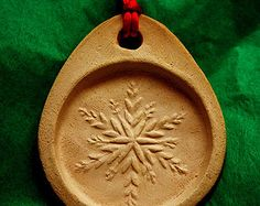 Frozen Snowflake Stoneware Cookie Mold doubles as Ornament