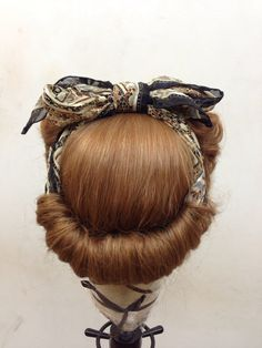 1940s victory curls front sides, then tie a scarf around head on top of the hair, take all hair hanging down and tuck it inside the scarf and pin to cover the bottom semi circle of the scarf.