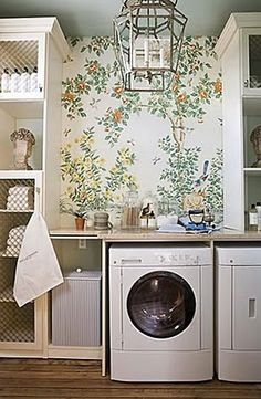 beautiful laundry room with wall paper and built ins