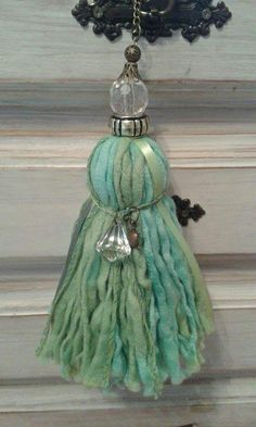 Tassel from thick and thin yarns and ribbons, adorned with transparent beads and metallic elements. Nice for home decoration, o Cute Crafts, Diy And Crafts, How To Make Tassels, Diy Tassel, Passementerie, Textile Jewelry, Felt Fabric, Shabby Chic, Crafty