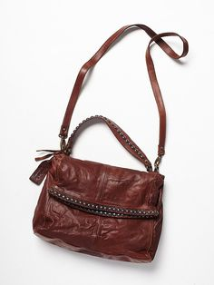 The perfect sized foldover crossbody with metal studs. Inside features one zip pocket and one hidden zip on the back. Handle strap and a removable long strap. Free People Greyson Leather Crossbody, C$476.15