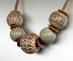 Hollow beads made by ST-Art-Clay (Tutorial Christine Dumont at http://www.allovercreation.net/learn/index.php)