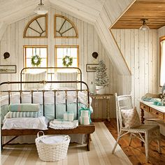 whitewashed knotty pine walls and illusion of an arched window. kept part of ceiling natural.