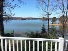 Million dollar views for 1/2 the price from this remodeled waterfront home on Lake Norman. The perfect private getaway. Updates in 2007 include a great room addition with stone fireplace (gas logs), HVAC, roof, hardwood floors, windows, composite decking, kitchenette, doors, tile flooring and covered boat dock & lift w/ deep water. Literally waterviews from every room! Home warranty included.