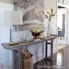 Here's the new entry look.This @ballarddesigns table makes the space feel much more open. I paired it with a crystal and brass lamp from @potterybarn  and a few fall accessories. I moved my @pier1 art work here for now, while I search for just the right piece for this space. Happy Thursday friends! The weekend is almost here! Tap for resources!