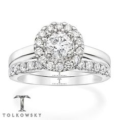 Beauty and excellence come together in this magnificent Tolkowsky® bridal set for her. The engagement ring features an exciting Tolkowsky® Ideal Cut round diamond at the center encircled by additional round diamonds. More round diamonds shimmer along the matching wedding band. Fashioned in lustrous 14K white gold, the bridal set has a total diamond weight of 1 carat. Each Tolkowsky® diamond ring comes with a certificate of authenticity and independent certification of the cent...