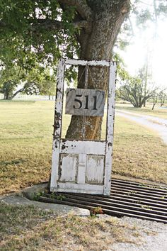 Into the shabby chic look? Hang a number sign from an old, distressed wooden door for a dose of country charm.
