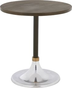 $299 on a pedestal.  Modern bistro table is a versatile entertainer in small spaces.  Dines four in the kitchen, sides up to the sofa, or rests easy as a bedroom nightstand.  Café-style diner pedestals a warm round of solid sustainable mango wood on a mixed tri-metal base of gleaming aluminum, matte black iron and a ring of antiqued brass.