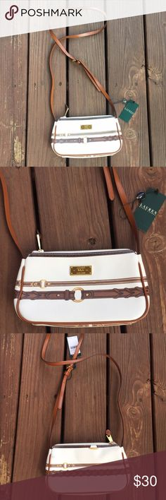 NWT Ralph Lauren Cross Body Bag Adorable cross body bag!! Brown strap. Gold hardware. Perfect for spring!! Pls note there are two small marks on the back top left side of the purse (see last 2 pictures). Lauren Ralph Lauren Bags Crossbody Bags