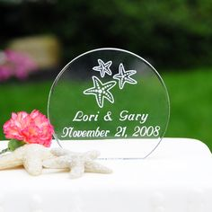 Bring in the warmth of a seaside sunset with our Beach Wedding Acrylic Round Cake Topper. Crafted of the finest acrylic, this cake top will showcase your eternal love brilliantly. Personalized free of charge and classically formed, it is the key choice to top your wedding cake. Details: Size: Measure 4 inches by 4 inches by a 1/2 inch thick Materials: Acrylic%2...