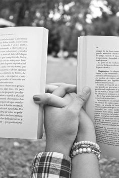 This would be an AMAZING engagement and/or wedding photo for a book lover such as myself. Love it!