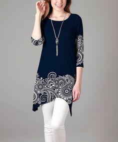 Loving this Blue & White Paisley Tunic - Plus on #zulily! #zulilyfinds.Enliven your casual ensembles in comfort thanks to this tunic's eye-catching print and lightweight stretch blend.  1X = 14W-16W, 2X = 18W-20W, 3X = 22W-24W, 4X = 26W Size 1X: 36'' long from high point of shoulder to hem 60% polyester / 35% rayon / 5% spandex Machine wash Imported