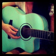 falling in love with my turquoise guitar @Youlia Salim