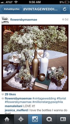 Metallic gold silver baby's breath centerpiece recycled wine bottles