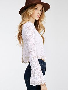 This country-chic top totes allover lace finished with homey crochet trim. Size note: This item runs small. Ordering two sizes up is recommended. Shipping note: This item is shipping internationally. Allow extra time for its journey to you. Cheap Crop Tops, Cute Crop Tops, Cropped Tops, Latest Street Fashion, High Fashion, Long Sleeve Crop Top, Bell Sleeve Top, White Lace Blouse, Crop Blouse