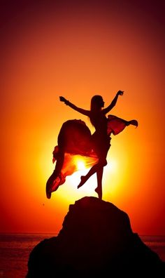Rising Sun. Oh, how I would love to see the sun rise over the water, dancing on a rock! Literally, I would love to do tha
