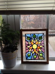 Create your own stain glass decor with dollar store frames.