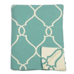 With its' vibrant reversible aqua beach blue and natural ivory shades, this enchanting flat knit throw is made with super soft cotton and is a joy to wrap into.