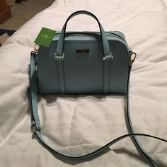 NWT, Kate Spade Tiffany Blue Color Small Felix bag Brand new with tags, never carried, authentic, small felix, Newbury Lane, blehydrnga 417 style. A light blue Tiffany color. Measures 9 inches deep inside purse and length of purse is about 12 inches. Good sized, handle or strap carry. kate spade Bags Shoulder Bags