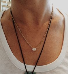 Do you have a stone you no longer wear or is just in need of an update? This is an amazing emerald cut diamond that was originally set in an engagement ring. We reset it in a handmade gold chain necklace and now she wears it every day! Don't worry they are still married!