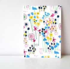 My love of flowers and doodling led me to produce a series of floral gardens.    This Floral Garden is scattered with blue, pink and yellow