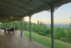 The rear verandah extends across the back of the home for obvious reasons! — at Samford, QLD.