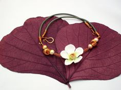 NEW! One of my playful jewelry items listed! Colourful necklace with a big white flower decorated by EvAtelier1, $26.80