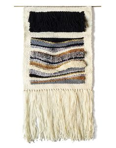 Tapestry woven on a simple frame loom and hung on a brass rod. Size is 10x20 inches including fringe.    Warp is grey cotton thread, weft is yarn