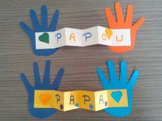 Les petites mains sont reliées par une bande de papier pliée en accordéon. Le tout est décoré à l'aide de gommettes par les enfants de bientôt 3 ans.