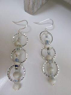 A personal favorite from my Etsy shop https://www.etsy.com/listing/268148297/dangle-earrings-silver-blue-and-white