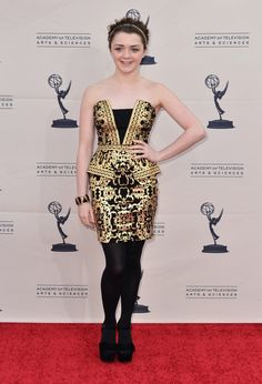 Maisie Williams from Game of Thrones in a black and gold cocktail dress! Love the whole outfit