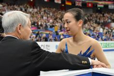 Mao Asada of Japan celebrates with her coach Nobuo Sato after her routine in the Ladies Free Skating during ISU World Figure Skating Championships at...