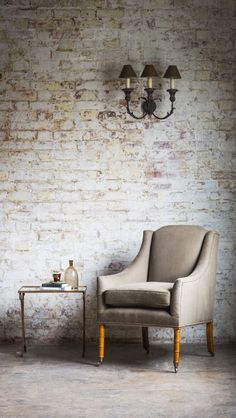 The Alexandra chair is a small elegant armchair. It has a separate seat cushion and gently sloping arms.