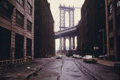 Manhattan Bridge tower in Brooklyn, New York City, framed through nearby buildings, in June of 1974. (Danny Lyon/NARA) #