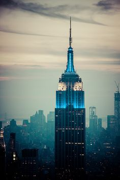 Empire State Building lit up in blue.