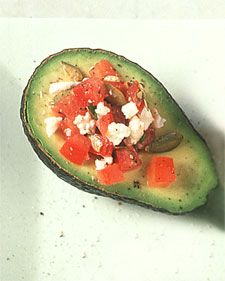Avocado stuffed with tomatoes and feta - Serve these with a spoon to scoop out the filling.