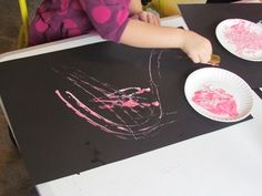 """Combining the use of the familiar 'toy car' and paint through this art activity of """"Painting with car tracks"""""""