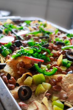 Vegan loaded nachos recipe with tomatillos and vegan queso cheese sauce. Its easy to make and makes a perfect appetizer or a meal! Vegan Lunch Recipes, Delicious Vegan Recipes, Clean Recipes, Easy Healthy Recipes, Vegan Meals, Vegan Food, High Protein Vegan Snacks, Queso Cheese, Cheese Sauce