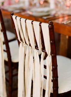 Get a gauzy material in the color of the wedding tied to the back of each chair. Love it.