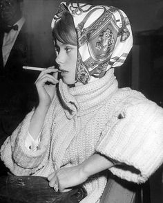 1961: Catherine Deneuve (wearing Hermès scarf) waiting at JFK airport.