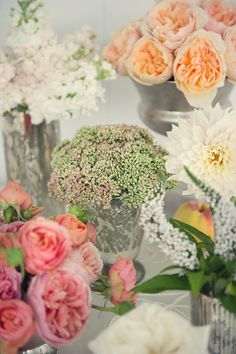 Peach and pink garden roses, white lilac.