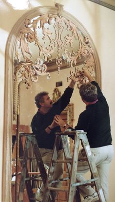 "James Evinczik Designed and made 3 of these Mirrors for a Ballroom in Private Residence in the DC area. Picture shows ornament being installed, they were Gilded and you can see a photo in folder ""creations of Villa Designs"""